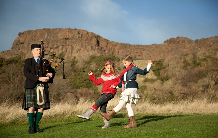 Girls dancing to the piper under Salisbury Crags
