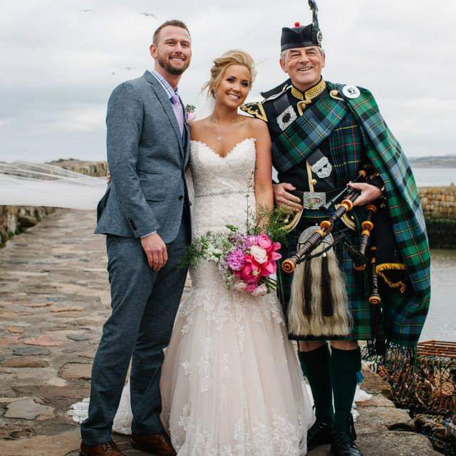 Piper with Wedding couple at St Andrews pier